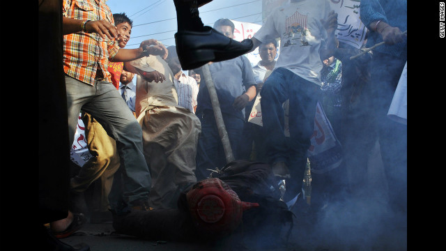 Pakistani demonstrators beat an effigy of Florida pastor Terry Jones during a protest against an anti-Islam film in Lahore on Monday, September 24. More than 50 people have died around the world in violence linked to protests against the low-budget movie, which mocks Islam and the Prophet Mohammed, since the first demonstrations erupted on September 11. See more of CNN's best photography.