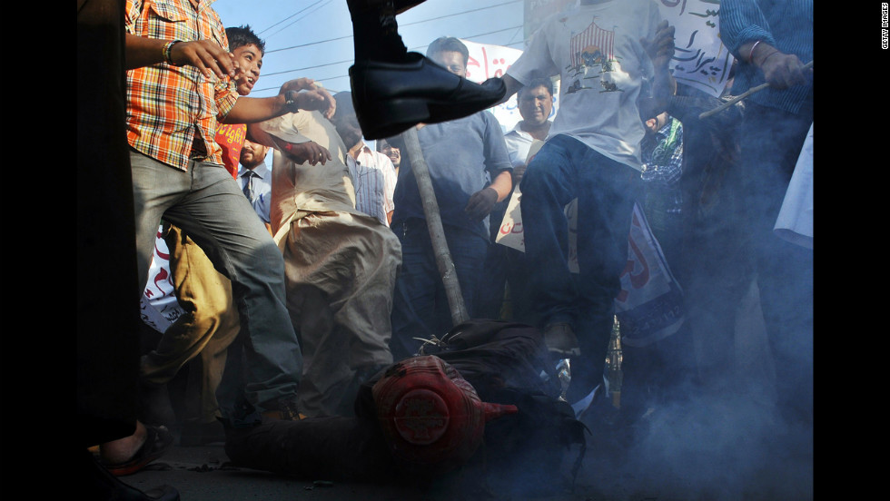 Pakistani demonstrators beat an effigy of Florida pastor Terry Jones during a protest against an anti-Islam film in Lahore on Monday, September 24. More than 50 people have died around the world in violence linked to protests against the low-budget movie, which mocks Islam and the Prophet Mohammed, since the first demonstrations erupted on September 11. <a href='http://www.cnn.com/SPECIALS/world/photography/index.html'>See more of CNN's best photography</a>.