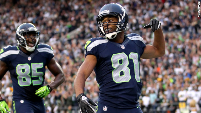 Seattle's Golden Tate, right, celebrates after scoring a 41-yard touchdown in the second quarter Monday.