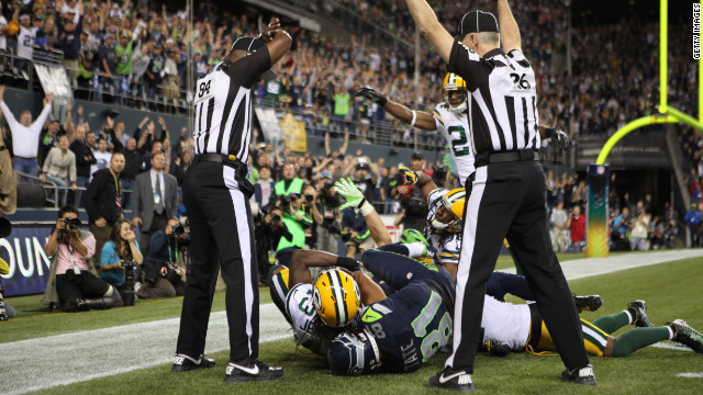 Officials in the end zone give different signals on the final play of the Green Bay-Seattle game on Monday night. The Seahawks beat the Packers 14-12 on a controversial call in the end zone on the final play at CenturyLink Field in Seattle. Check out the action from Week 3 of the 2012 National Football League season. Look back at the best of Week 2 and see more of CNN's best photography.