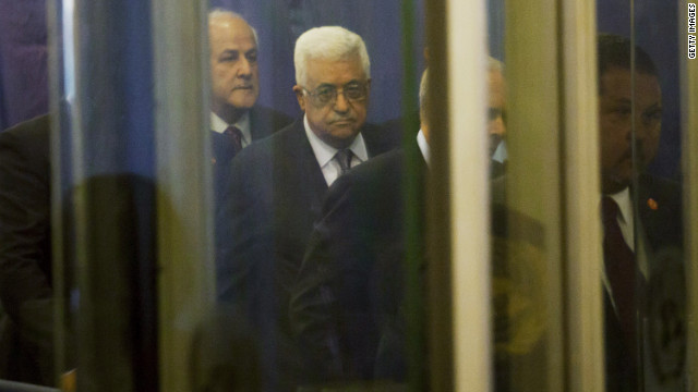 Palestinian Authority President Mahmud Abbas, center, arrives at the United Nations on Tuesday.