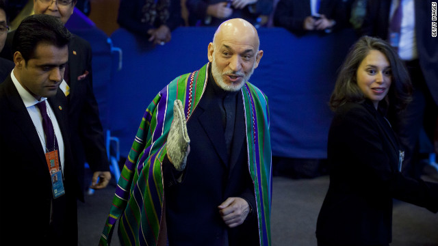 Afghan President Hamid Karzai, second right, arrives on Tuesday.