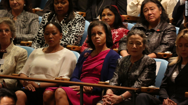 First lady Michelle Obama, center, listens to her husband speak on Tuesday.