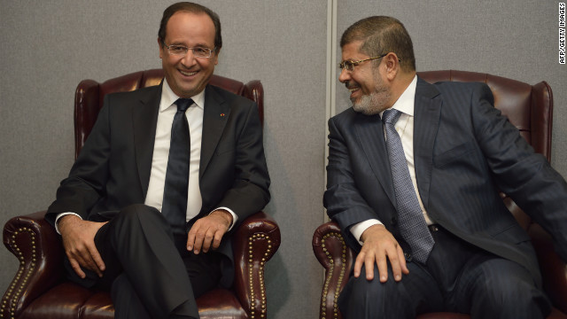 French President Francois Hollande, left, and his Egyptian counterpart Mohamed Morsy talk during a bilateral meeting on Tuesday, September 25, at the United Nations in New York during the annual General Assembly. The event gathers more than 100 heads of state and government for high-level meetings on nuclear safety, regional conflicts, health and nutrition and environment issues.