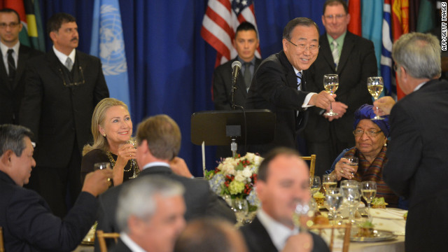 United Nations Secretary-General Ban Ki-moon, standing, makes a toast during a luncheon on Tuesday and U.S. Secretary of State Hillary Clinton, left, looks on.