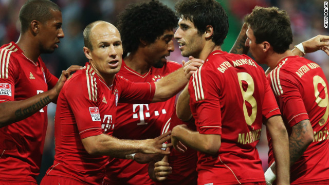 Bayern Munich's players celebrate a goal for Mario Mandzukic in their victory over Wolfsburg at the Allianz Arena.