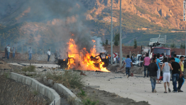 A vehicle burns after an explosion in the center of Tunceli on September 25, 2012.