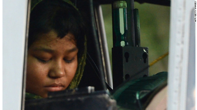 Rimsha Masih sits in a helicopter after her release from jail in Rawalpindi on September 8, 2012.