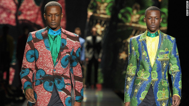 "Ozwald Boateng's collections included ""somber black suiting, casual sand and salmon linen shorts and blazers and some riotously colourful shirts and trousers made from Vlisco wax prints,"" according to Jennings."