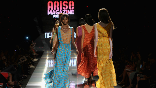 "Folake Folarin-Coker's creations for Tiffany Amber ""offered up floaty resort-wear with decadent 1970s overtones,"" according to Jennings. ""Entitled The Rhythms Of Africa, jewel-coloured silks were hand printed with drum motifs and formed waist-cinching maxi dresses, jumpsuits and rompers."""