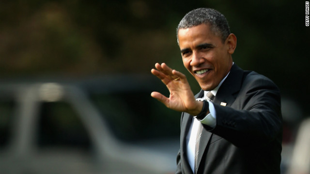 President Barack Obama waves to visitors before leaving for a campaign trip to Ohio on Wednesday, September 26.
