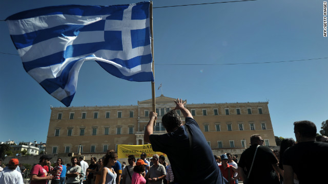 A protester holding a Greek flag gestures toward parliament in Athens on Wednesday, September 26. Greek trade unions called a 24-hour general strike to oppose new austerity measures. Police said some protesters threw Molotov cocktails in Syntagma Square, opposite the parliament building. Police responded with tear gas. &lt;a href='http://www.cnn.com/2012/09/26/europe/gallery/spain-protest/index.html'&gt;See anti-austerity protests in Spain&lt;/a&gt;.