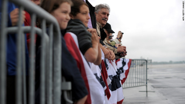 Supporters wait to see President Barack Obama on Wednesday at Toledo Express Airport in Bowling Green, Ohio. Air For One aborted an initial landing attempt in Ohio due to weather conditions.