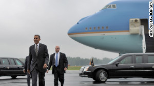 President Barack Obama landed safely in Ohio on Wednesday after Air Force One aborted an initial landing attempt at the airport due to weather conditions.