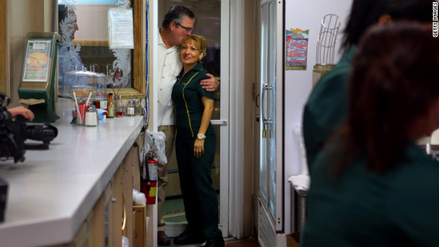Former Florida Gov. Jeb Bush hugs a waitress as they wait for Ryan's arrival during a campaign stop at a restaurant in Miami's Little Havana neighborhood on Saturday, September 22.