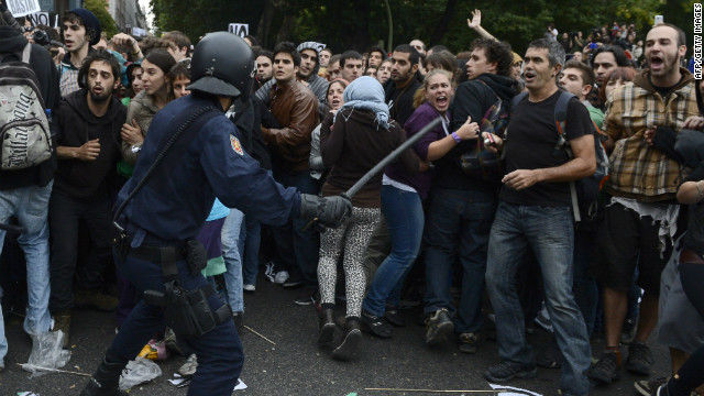 Protesters clash with riot police Tuesday in Madrid. At one point, police charged demonstrators with batons to prevent them from approaching Parliament, which was in session.