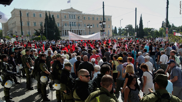 Thousands shout slogans in front of the Greek parliament during a general strike in Athens on Wednesday. The first nationwide strike since Greece's new coalition government was formed in June was called by Greece's two biggest labor unions.