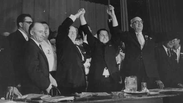 Hoffa, center, stands with other officials at the Teamsters convention, where he made a successful bid for control of the union in 1957.