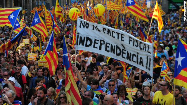 People hold pro-independence Catalan flags in a demonstration calling for independence in Barcelona.
