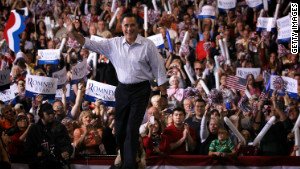 Mitt Romney waves as he arrives at a campaign rally at SeaGate Convention Centre September 26 in Toledo, Ohio.