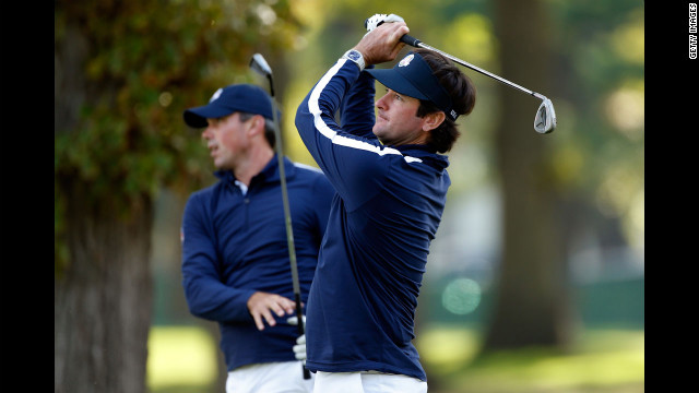 U.S. players Matt Kuchar and Bubba Watson hit shots on the practice ground Thursday.