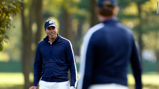 Matt Kuchar chats with U.S. teammate Webb Simpson on the practice ground on Thursday.