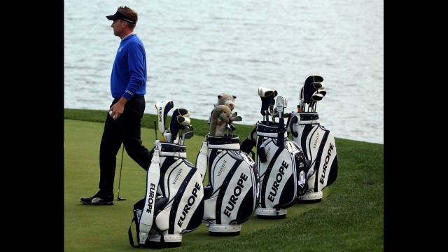 Ian Poulter of Europe practices near his teammates' golf bags Wednesday.