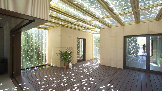 Light filters into the patio through the patterns on the walls and ceiling.