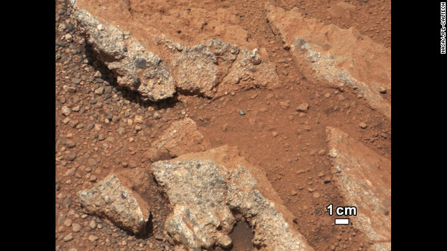 This photos shows an up-close look at an outcrop that also shows evidence of flowing water, according to the JPL/Caltech science team. The outcrop's characteristics are consistent with rock that was formed by the deposition of water and is composed of many smaller rounded rocks cemented together. Water transport is the only process capable of producing the rounded shape of conglomerate rock of this size.
