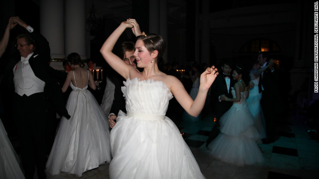 A debutante makes her high society debut at the first debutante ball to be held in China, in Shanghai, January 2012. Image courtesy of the Shanghai International Debutante Ball.