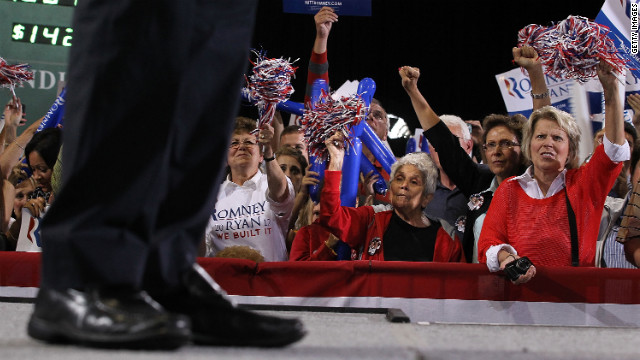 Supporters cheer as Romney speaks at SeaGate Convention Centre in Toledo, Ohio, on Wednesday, September 26.