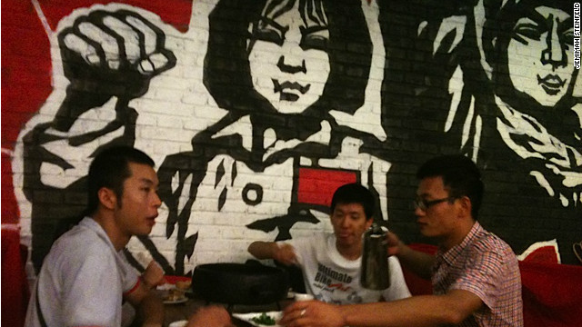 Patrons at a Cultural Revolution-themed eatery gather for snack and 