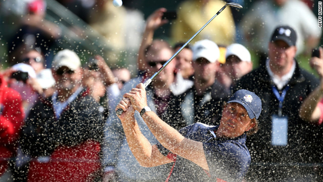 Phil Mickelson of the United States plays a bunker shot during the fourth and final preview day of the 39th Ryder Cup at Medinah Country Club on Thursday, September 27.