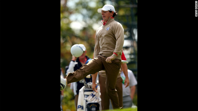 Rory McIlroy of Europe kicks a PGA ball in between play of the practice round Thursday.