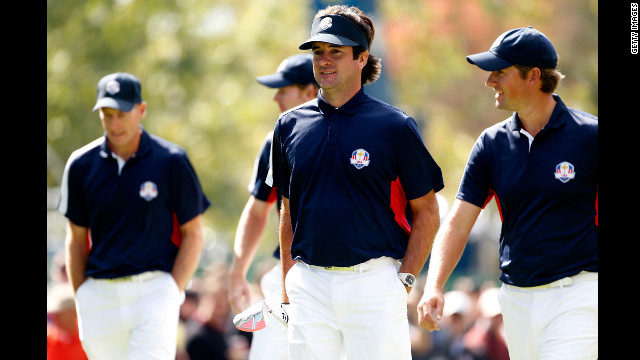 2012 Masters champion Bubba Watson, center, walks with U.S. teammate and U.S. Open winner Webb Simpson during a practice round Thursday.