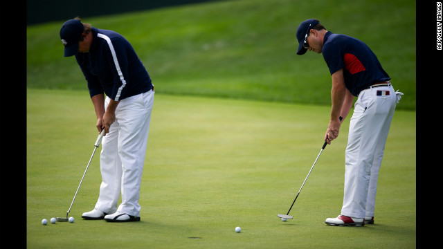 Zach Johnson, right, and Jason Dufner of the United States pratice putting on the 17th green Thursday.