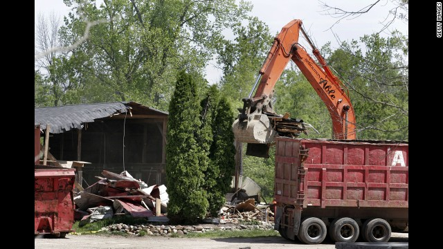 Demolition workers in 2006 tear down a horse barn for the FBI in a search for Hoffa's remains in Milford, Michigan. &lt;a href='http://www.cnn.com/2006/US/05/17/hoffa.search/index.html'&gt;The FBI had received a tip&lt;/a&gt; that Hoffa was buried on the farm.