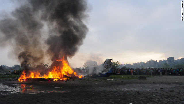 Flames engulf the small passenger plane, which was carrying tourists to a staging point for Mount Everest expeditions. The crash remains under investigation, but it appears the plane's collision with an eagle was a factor, an airport official said.