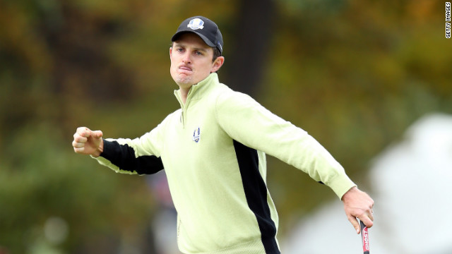 Justin Rose of Europe celebrates on the fourth hole after a long putt at the 39th Ryder Cup Friday at Medinah Country Club in Medinah, Illinois.