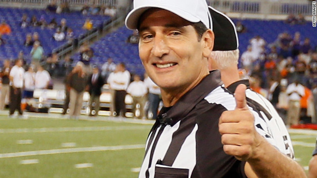 Referee Gene Steratore gives the thumbs after the game officials took the field for the first time this season before the start of last night's Ravens-Browns game
