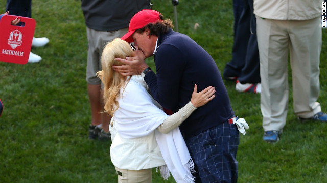 Phil Mickelson of the United States kisses his wife Amy on the first tee Friday.