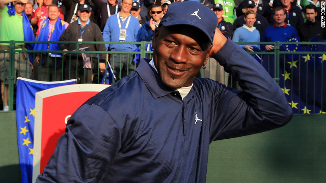 Basketball legend Michael Jordan waits on the first tee during the matches.