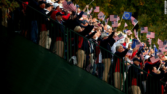 USA fans cheer the players on the first tee Friday.