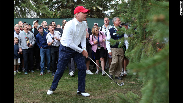 Steve Stricker of the United States hits a shot from the rough on the first hole.