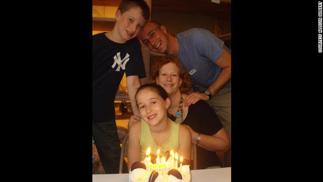 Gilbert, her husband, Mark, and their children, Jake and Lexi, at a birthday celebration.