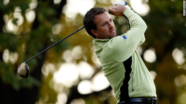 Graeme McDowell of Europe watches a shot during the Morning Foursome matches of the Ryder Cup on Friday.
