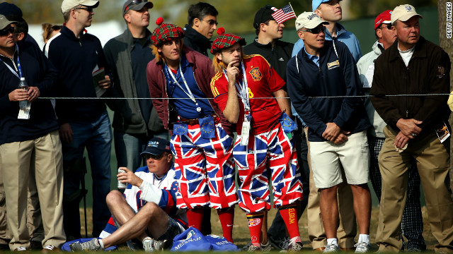 European fans watch the actiion in flamboyant outfits on Friday.