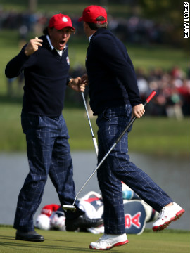 Phil Mickelson and Keegan Bradley celebrate on the 15th green after defeating Luke Donald and Sergio Garcia during the morning foursome matches on Friday.