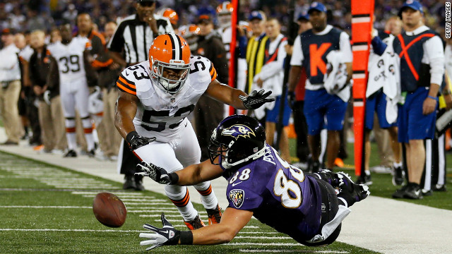 Ravens tight end Dennis Pitta, right, misses a pass against Cleveland middle linebacker D'Qwell Jackson.