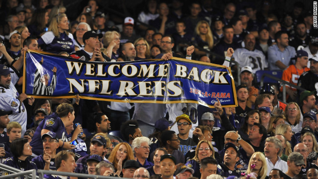 Ravens fans cheer the return of regular referees at M&T Bank Stadium in Baltimore.